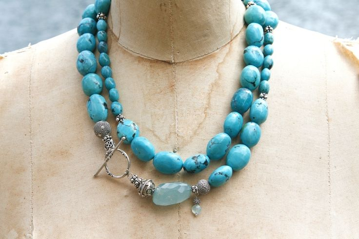 Turquoise stones mixed with sterling silver and an big bold aquamarine accent, with a decorative silver toggle.