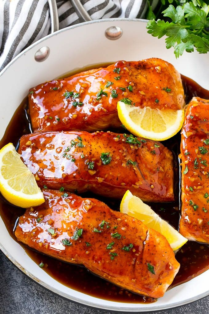 This honey garlic salmon is salmon fillets seared to perfection and coated in a sweet and savory honey garlic sauce.Tender salmon is smothered in a 5 minute sauce made from garlic, honey and soy sauce for a unique yet delicious meal that the whole family will love.