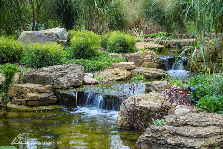 A beautiful waterfall helps to aerate the pond and drown out nearby traffic noise.