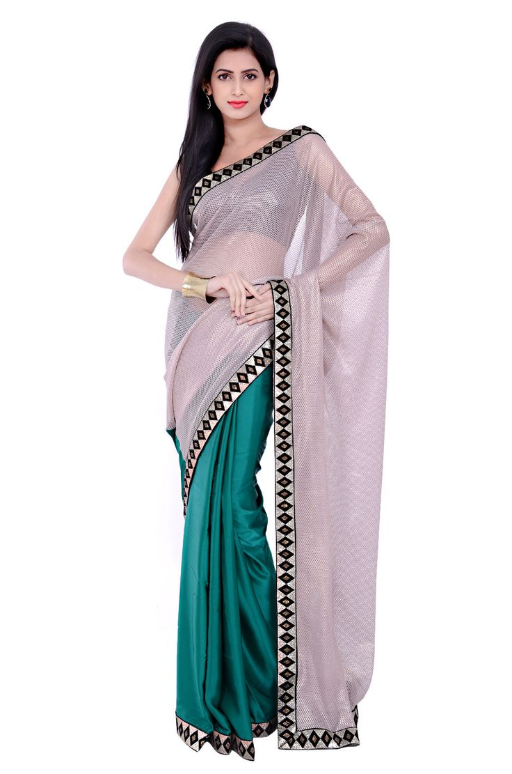 Look different in this elegant ivory half fancy lace and half pure satin saree. This enticing piece features velvet golden tissue with crystal embellished border. This saree comes with contrasting blouse piece. Wear this beautiful saree with stone jewelery and accessorize your look with an embellished clutch.