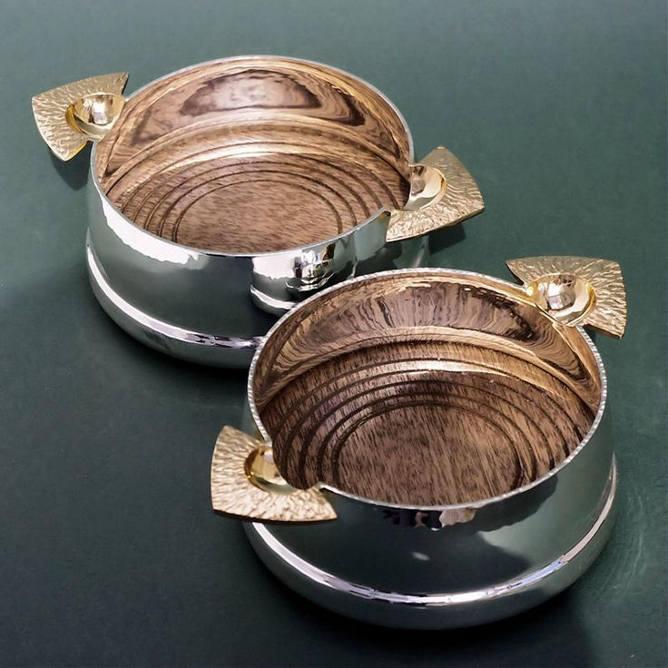 Silver wine coasters guilded finger grips mahogany base