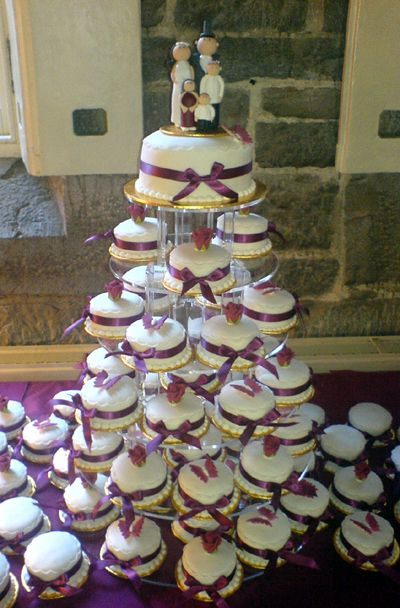 """Mini Cake Tower - Individual mini cakes made with cake fillings of your choice, iced and decorated with sugar flowers, fresh flowers, sugar butterflies etc.    The cakes are carefully set up on our special cake stand, with the optional addition of a 6"""" round top tier for ceremonial cutting.  http://www.divineweddingcakes.co.uk/mini_cakes.shtm#"""