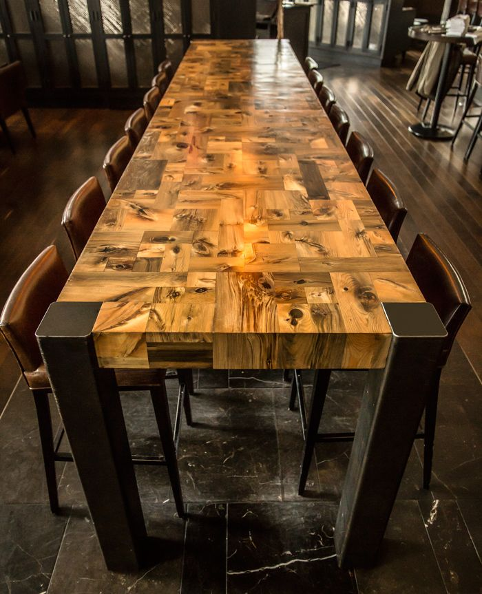 The Mosaic Table is a commission for e11even restaurant in downtown Toronto. The 14' communal table is composed of antique hemlock that was buried below York Street for over a century as a part of the historic Conner's Wharf. While below ground, the hemlock timbers absorbed the vivid green and red mineral tones in the lakefront soil. The surface is assembled from nearly 300 off-cuts that were individually cut and joined. The legs are made of hot-rolled, partially oxidized steel.