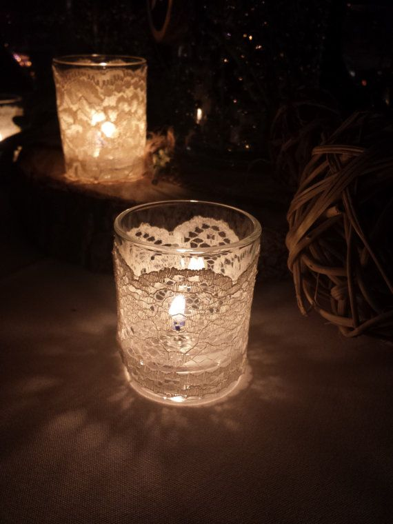 Lace wrapped votive candle holders.  Available at www.duryeaplace.com.