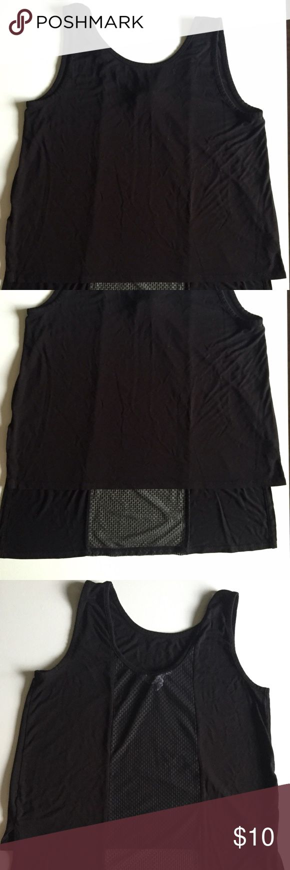 Black BCBGeneration Tank with Mesh Back Black tank top with a mesh section that runs down the back. The back of the shirt is longer than the front and the front length hits at the waist. BCBGeneration Tops Tank Tops