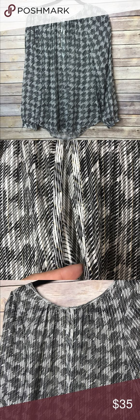 """WHBM Silk Metallic Gold Silver Blouse White House Black Market black and white silk blouse with gold and silver metallic trim Faux with hook and eye closure  Size 10 which translates to a medium according to the WHBM size guide. Armpit to armpit approx. 21"""" Length approx. 28"""" Excellent used condition, no flaws. MSRP $98 Smoke free home White House Black Market Tops Blouses"""