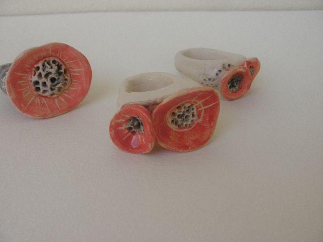 Anna Chronaki- ceramic flower rings, in coral.