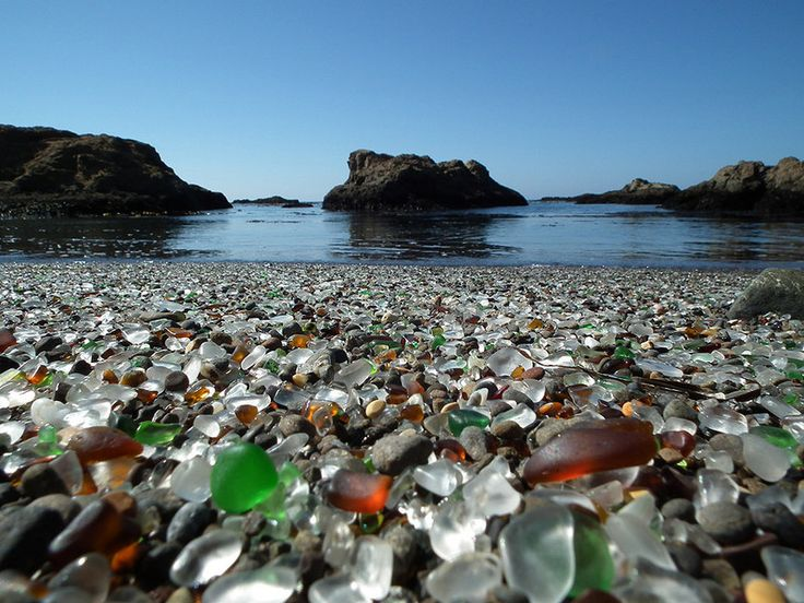 In Fort Bragg, California there is a beach where tons of broken glass washes ashore making it look like it's covered with gem stones.