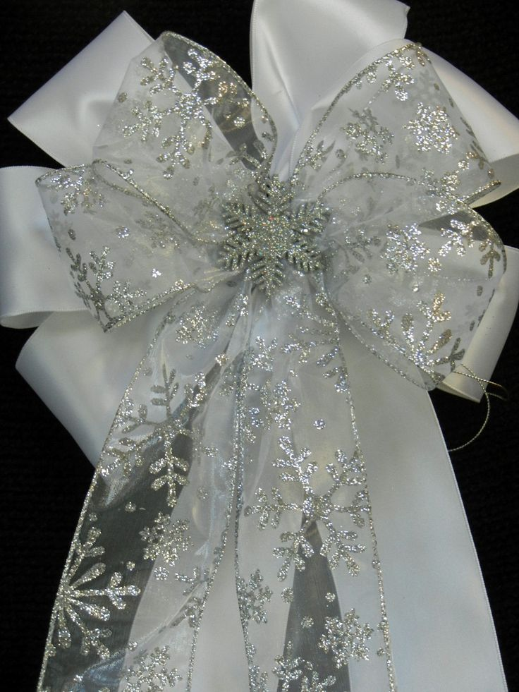 White Satin and Sliver Snowflake Decorative Christmas/winter wedding bow. $12.00, via Etsy.