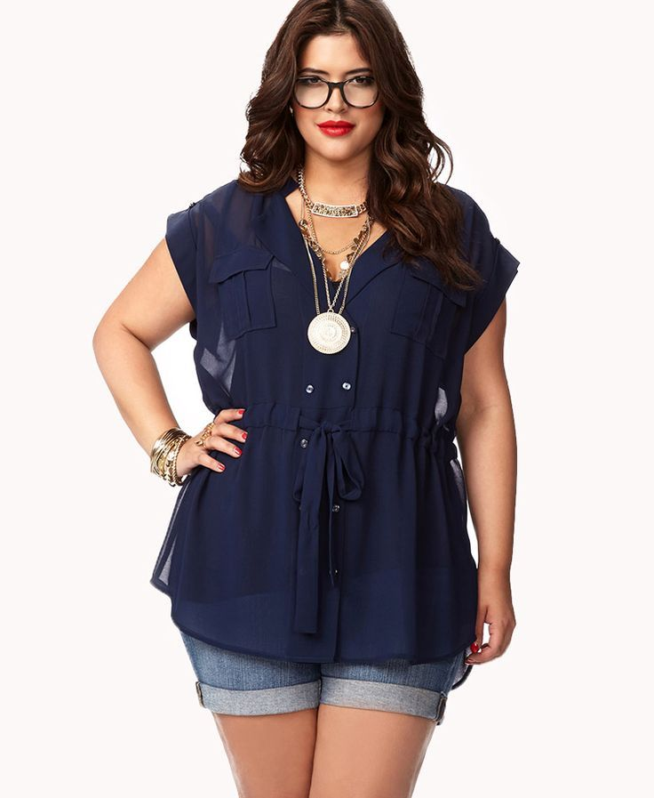 I like the built-in waistline of this loose, drapey top.  A good example of how to dress up shorts, too!