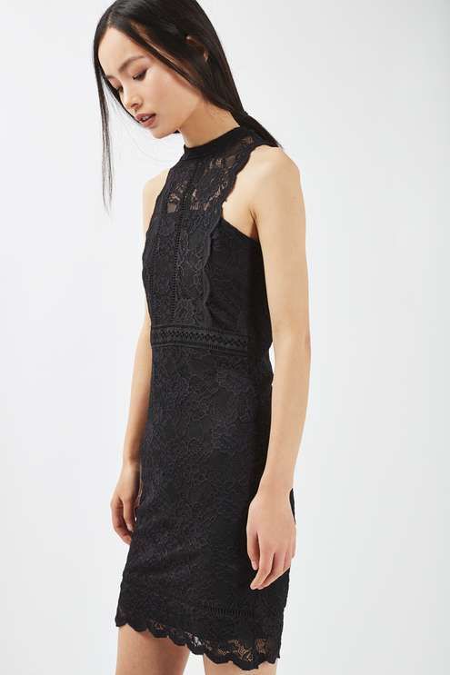Achieve party-dress perfection in this black mixed lace mini bodycon dress with pretty scallop edging. We love to wear with heeled sandals and a chic black clutch. #Topshop