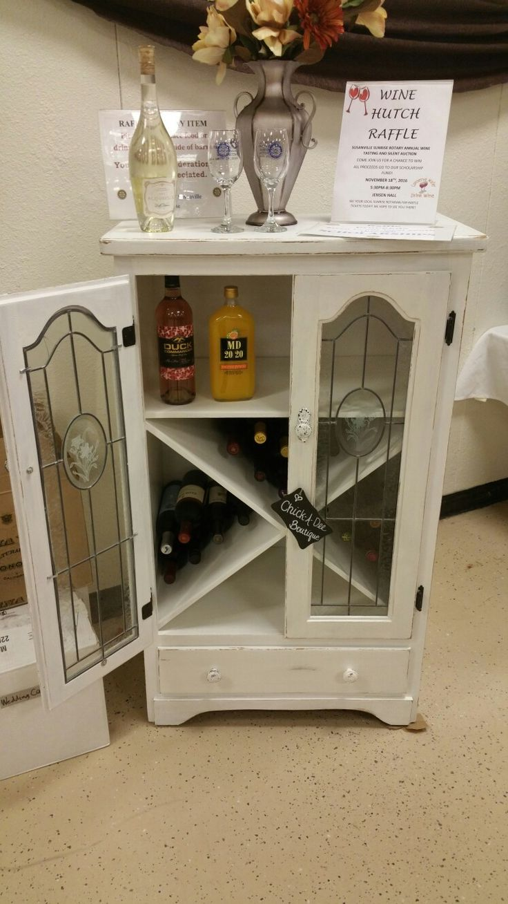 Donated to a local charity for a raffle.  Repurposed wine cabinet from a 90's steroids cabinet.
