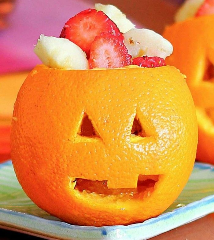 Prepare Decorations For Halloween In The Form Of Fruits