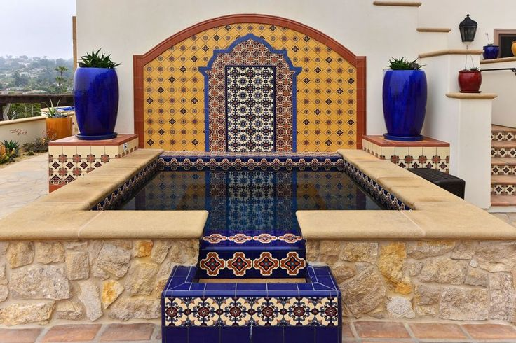 Southwestern Hot Tub with exterior stone floors, Fence