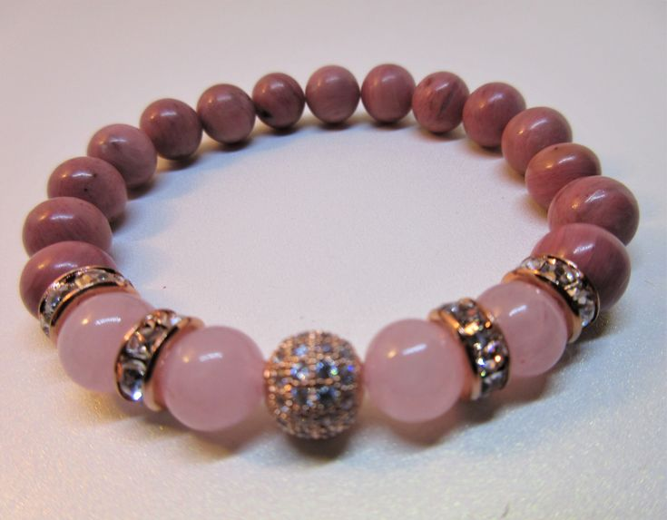Rhodochrosite 8 mm Stretch Bracelet with Rose Quartz and CZ Pave Rose Gold Ball ,Rose Gold Crystal Rondels.  You need this bracelet to attract your soul mate or buy as a gift  for someone you now that is looking for love. Click on the link to buy it today!