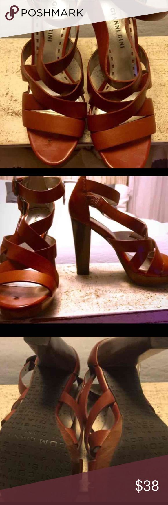 New Sz 6.5 Gianni bini Cognac Brown Strappy Heels Cognac Brown Strappy Gianni bini Heels Size 6.5 These are new but they have a small gouge as seen in picture. It is covered up while wearing them though. Gianni Bini Shoes Sandals
