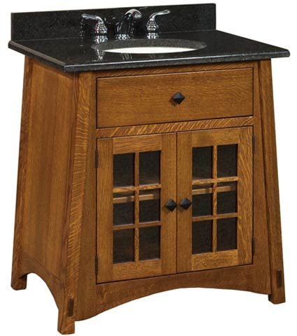 The McCoy Vanity comes with glass doors and an adjustable shelf. Put this vanity in any bathroom remodeling project for that country home feel. Shop today!