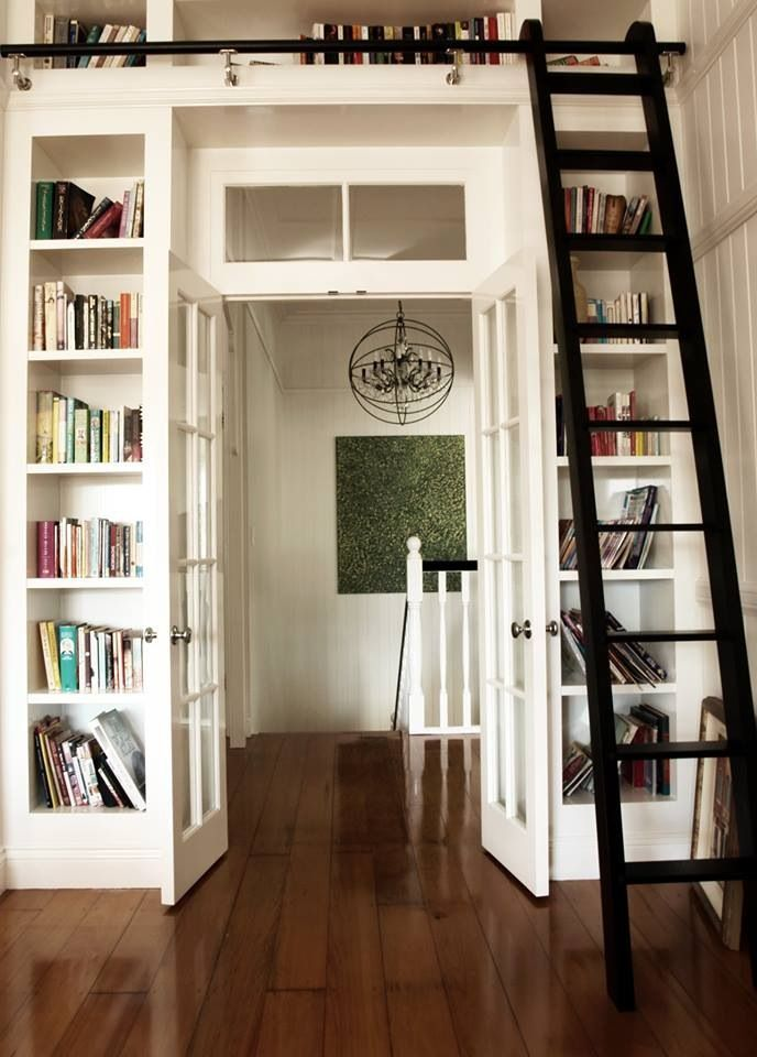 Bookcase and rolling ladder, who could resist? Queenslander renovation Trebilcock & Associates