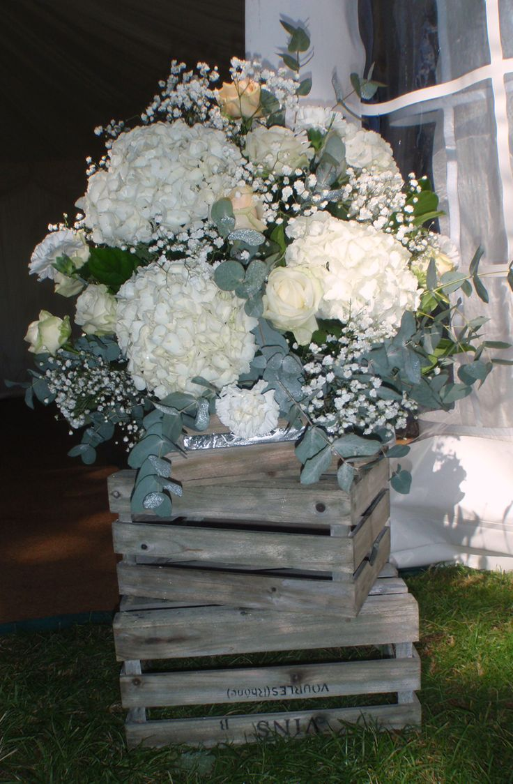 beautiful floral arrangement  made in wooden crates for entrance to marquee