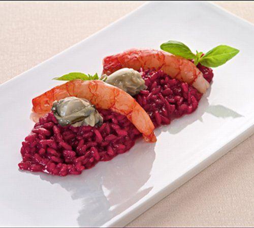 Il risotto al Karkadè con gamberi rossi e fiori di basilico è una ricetta d'alta cucina che unisce acidità, dolcezza e sapidità in un mix unico e inconfondibile di sapori che renderanno particolarmente raffinata ed elegante la vostra cucina.