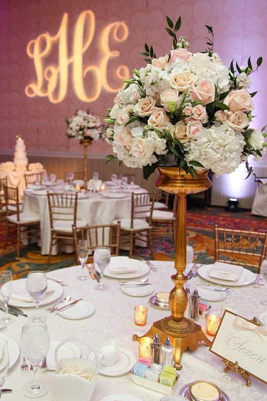 Monogram gobo and pretty pastel wedding centerpiece