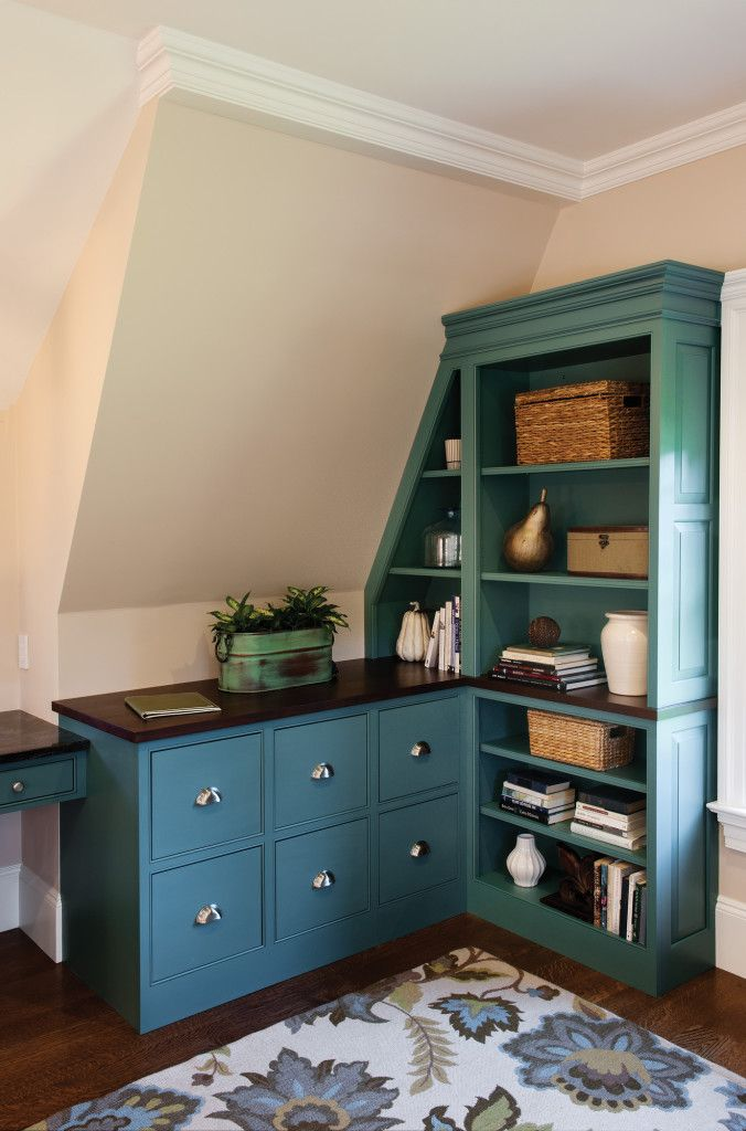 Tranquil Color in a Shared Office: Custom corner built-ins with six file drawers and bookshelves built right up to the angled ceiling.  Solid wood top.