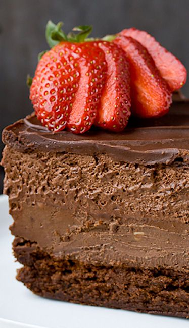 Quadruple Chocolate Mousse Cheesecake Recipe ~ Flour less chocolate cake, chocolate cheesecake, chocolate mousse, and chocolate ganache make up this 4 layer chocolate delight!