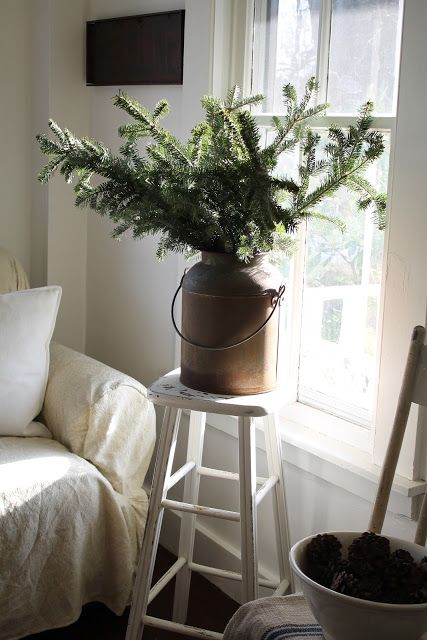Great idea for Christmas decor - branches in a vintage pail.