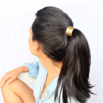 Modern Hair Tie - Large  Large Metal Hair Tie with removable hair elastic. Available in Brass or Copper by Caravan Pacific. Produced and Assembled in Portland, Oregon