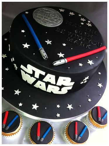Star Wars cake and cupcakes. This would be perfect for Joshua and Isaiah  a lightsaber for each.