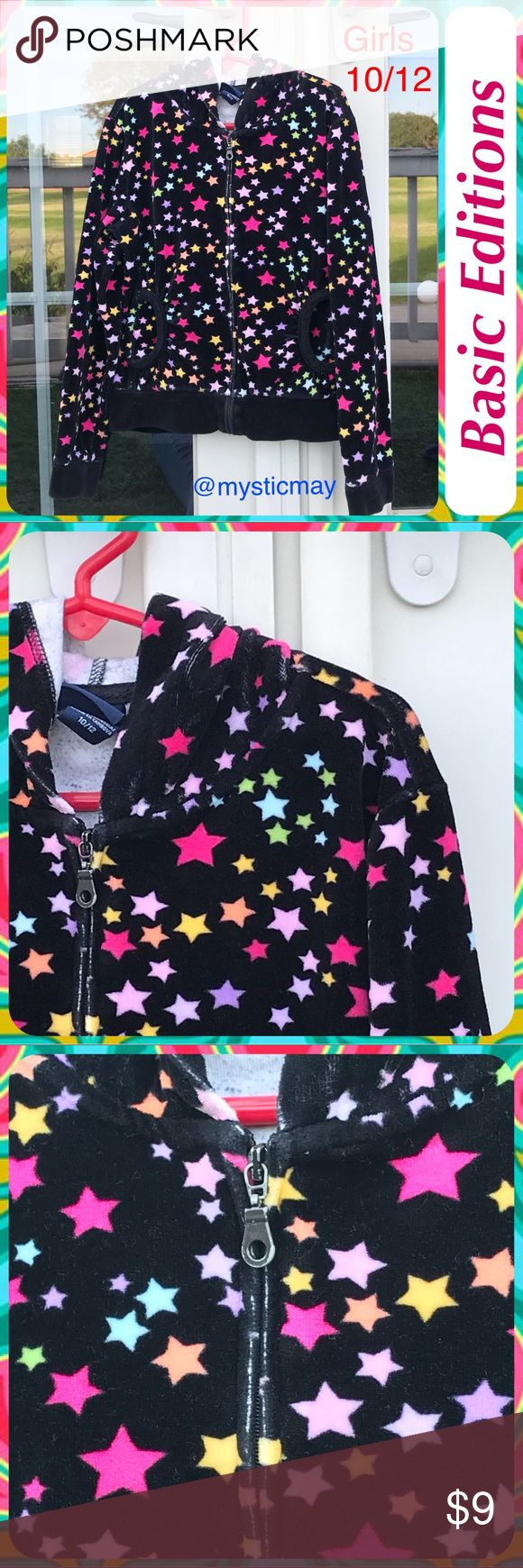 """Girls Black Velour Rainbow Star Zip-Up Hoodie Sz M Super soft Black Velour Hoodie Jacket with multi-color star design throughout! Zips up. Lightweight with circular pockets at the waist. Long sleeves. Girls Size M or 10/12. Measures 16"""" across the chest and 17"""" in length. In Good Condition- some wear on the velour by the zipper and some color fade near the hemline. See pics. Basic Editions Shirts & Tops Sweatshirts & Hoodies"""