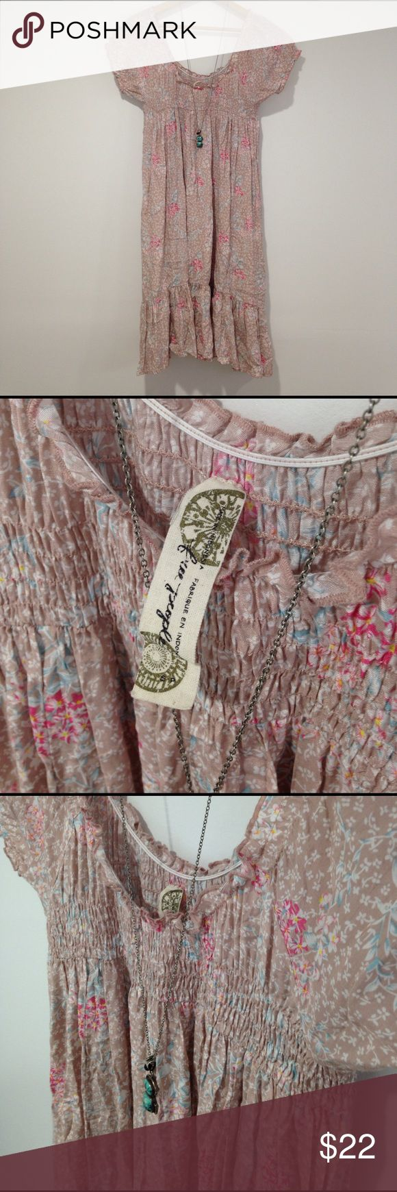 Free People floral smocked peasant summer dress S Once again I'm suffering from sellers remorse! Barely worn taupe, pink and blue floral Free People dress. Smocked top with elastic cap sleeves and a ruffle bottom. Beautiful neutral print that looks great alone or with a jean jacket. Size small but the looser silhouette could accommodate a medium. Free People Dresses