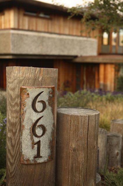 house number sign love the rustic sign on a wooden post in the front garden