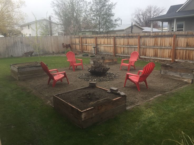 Fire pit area with pea gravel on top of landscape fabric for Gravel fire pit area