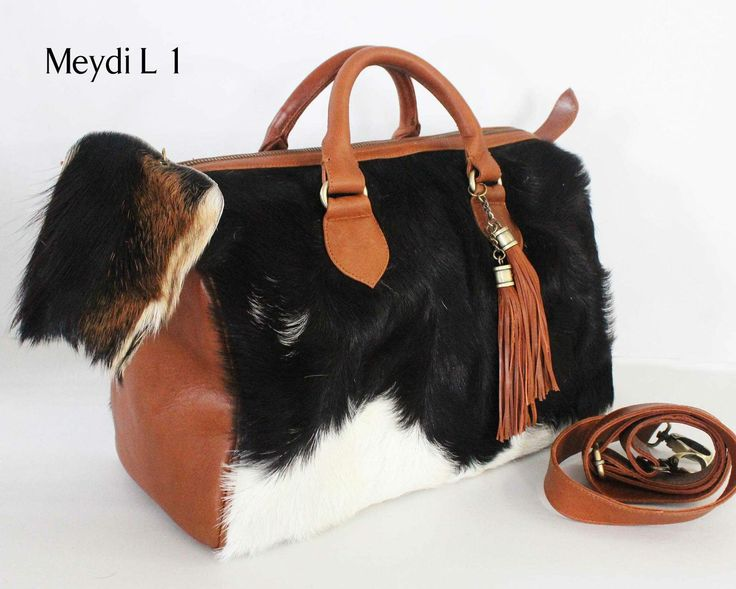 Beautiful calfskin leather with combination of soft lamb fur...man made. Product of indonesia ...