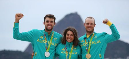 RIO DE JANEIRO, BRAZIL - AUGUST 16: (L-R) Jason Waterhouse of Australia and Lisa Darmanin of Australia celebrate winning the silver medal in the Nacra 17 Mixed class and Tom Burton of Australia celebates winning the gold medal in the Men's Laser class on Day 11 of the Rio 2016 Olympic Games at the Marina da Gloria on August 16, 2016 in Rio de Janeiro, Brazil. © 2016 Getty Images