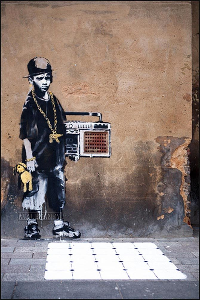 new from Banksy, an old school hip hop kid with his teddy bear  artist: Banksy  location: dalston, london, england