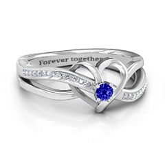 This breathtaking ring represents a love that lasts forever. The beautiful 3mm round center stone is enhanced with sparkling accent stones running through the heart into the intricate band. Show your girlfriend, best friend, daughter or mother that you will always love her and that she is the most important woman in your world.