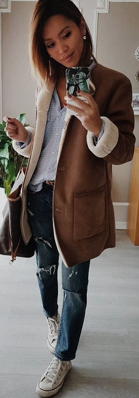 #winter #outfits brown suede button-up jacket and distressed blue denim jeans