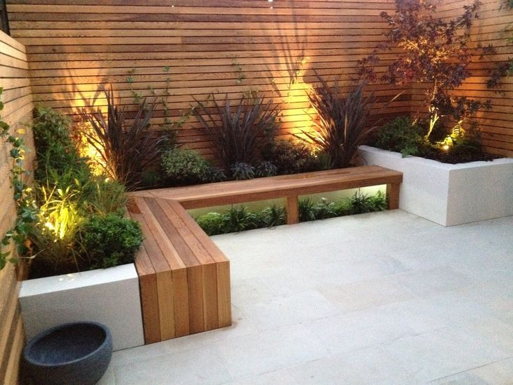 Bench, concrete planters and lighting