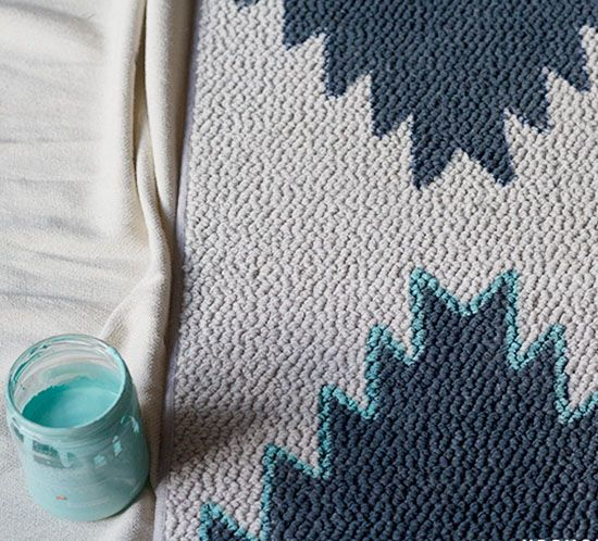 PIN this for later! See how easy it is to transform a boring rug into a custom piece with paint! DIY Painted Rug | MountainModernLife.com
