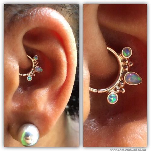 """thrivestudios: """"Pierced By @thrivinjesse """"Camille drove two hours to visit @thrivestudios to upgrade her healed daith piercing! She instantly fell in love with this 14k rose gold """"Eden Pear"""" ring with white opals from @bvla fits her ear perfectly...."""