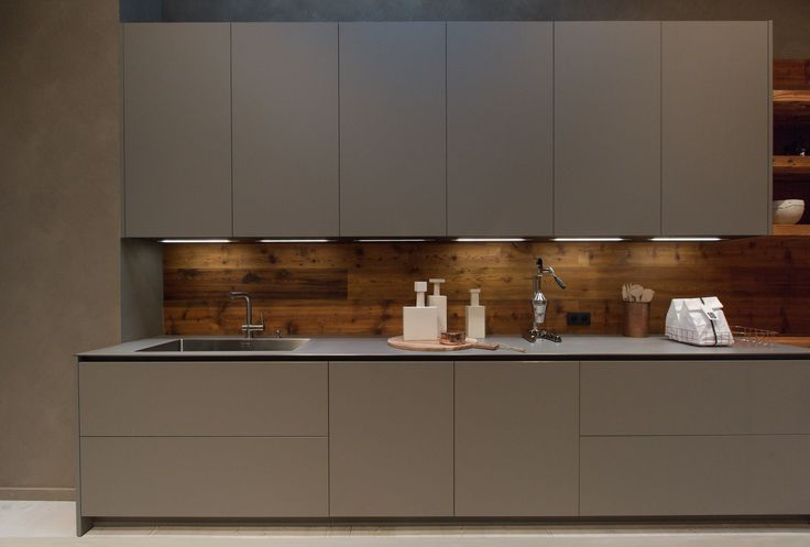 A second composition on show in the store is in a more modern style which blends new materials such as the innovative Fenix laminate in lead grey of the doors and columns and the hot-rolled steel of the work top with the natural warmth of antique-effect spruce.  #design #kitchen #interiors #interiordesign