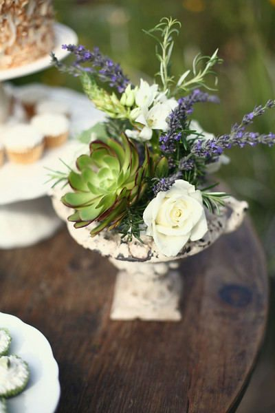 Succulents roses lavender and rosemary centerpiece
