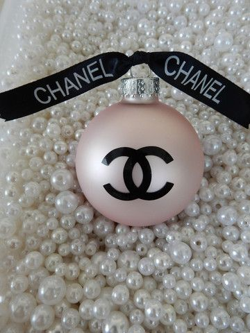 Love this! CHANEL INSPIRED PINK ROUND GLASS CHRISTMAS TREE ORNAMENT CC RIBBON GIFT LARGE. Just click and see all the fun Chanel Christmas Decorations they have for sale!! So affordable so cute great stocking stuffer for a little something for someone special