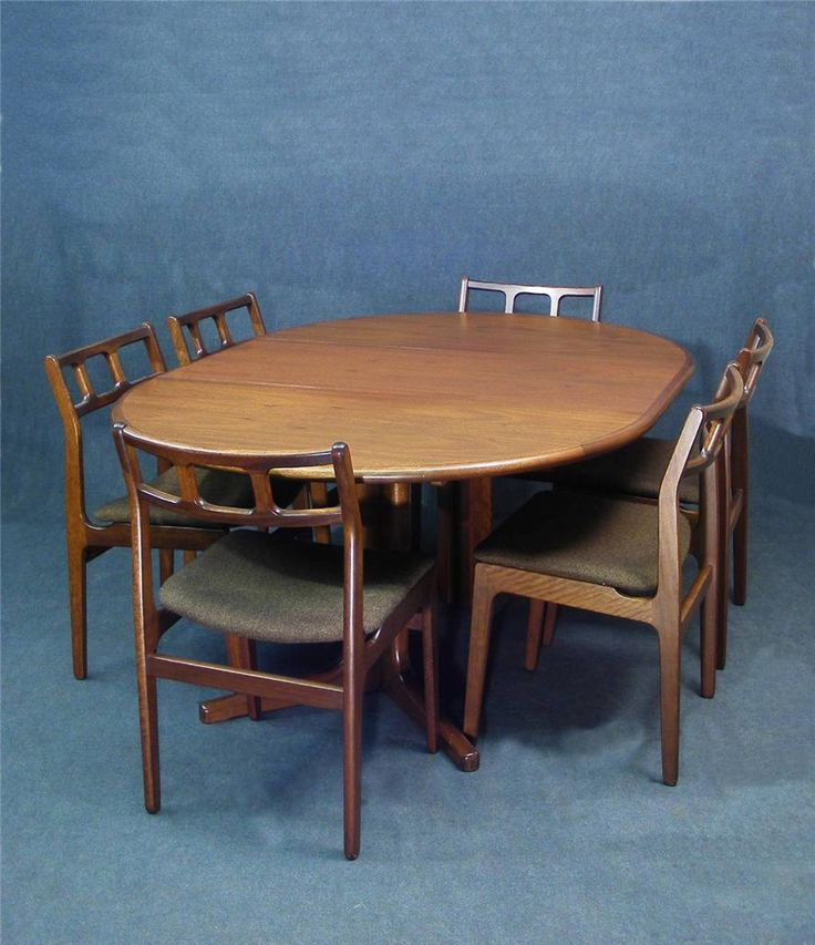 A wonderful vintage Danish rosewood extending dining table  Seats up to 6  The table Combines great design and quality construction  Superb solid rosewood top with fabulous colour, grain and sheen  Table extends via an extra leaf taking the table from circular to oval  Beautiful solid construction   Stylish V shaped legs and feet giving the table strength and support and makes it possible for chairs to be placed around the entire table