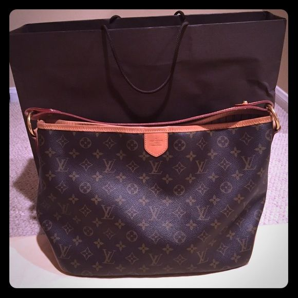 ** Authentic Louis Vuitton Delightful PM** Authentic Classic Louis Vuitton Monogram Delightful PM. Pre loved. Normal wear/rubbing on leather trim and some pen mark/stains on inside and on strap. Piping all in tact. Smoke free home. NO TRADES. Low ballers will not be entertained - not in a hurry to sell this beauty!!Bundle discount does not apply. 15.0 x 11.0 x 4.7 inches  (Length x Height)  (See additional listing for DATE CODE) Louis Vuitton Bags Shoulder Bags
