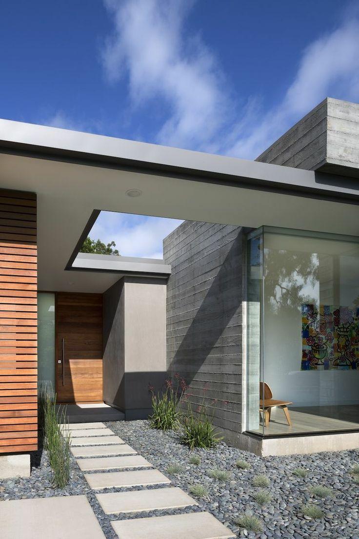 terrassenplatten-beton-minimalistisch-kieselsteine-grau-weg-passivhaus