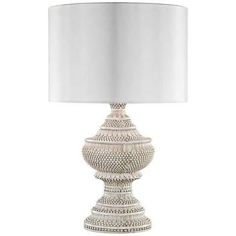 Keep your outside living spaces modernly stylish with the stunning white finish of this traditional table lamp.