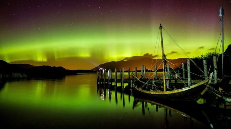 A stunning display of the aurora borealis over Derwentwater, near Keswick, in the Lake District, with an interesting foreground.